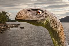 Loch Ness Monster of Nessie is een schepsel bovengenoemd om in Loch Ness in de Schotse Hooglanden te wonen royalty-vrije stock foto