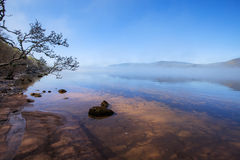 Loch Ness over the morning fog. Stock Image