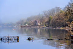 Loch Ness shoreline in the morning foggy haze Royalty Free Stock Images