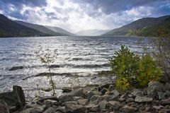 A loch in scotland. Lake or loch in the highlands of scotland with mountains and stormy sky Royalty Free Stock Photo