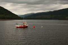 A loch in Scotland on a grey day stock images