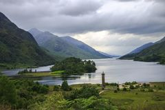 Loch Shiel and memorial to the Jacobites, at Glenfinnan, Lochaber, Scotland royalty free stock photo