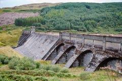 Loch Tarsan Dam Argyll and Bute Scotland UK. Dam on freshwater Loch Tarsan lake used as impounding reservoir supplying water to the Striven Hydro-Electric Scheme Royalty Free Stock Photo