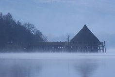 Loch tay crannog. A reconstruction of an ancient building, a crannog, on the misty shores of Loch Tay, Scotland royalty free stock photos