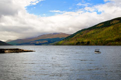 Loch Tay in Scotland. Loch side view with blue sky and dramatic clouds Royalty Free Stock Image