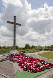 Lochnagar mine crater memorial and wreaths. LOCHNAGAR MINE CRATER MEMORIAL, LA BOISSELLE, SOMME, FRANCE - JULY 01, 2012 Wreaths of poppies laid at the foot of Stock Images