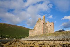Lochranza castle. Ruined castle in Arran, Scotland on a summer evening stock images