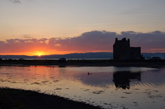 Lochranza Castle, Arran. Lochranza Castle in Arran, Scotland at sunset Stock Photo