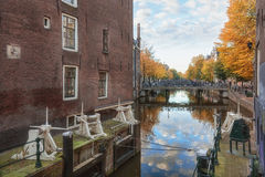 The lock between Сanal Oudezijds Kolk and Oudezijds Voorburgwal. Amsterdam, Netherlands – October 30, 2016: The lock between Сanal Oudezijds Kolk and Royalty Free Stock Photos