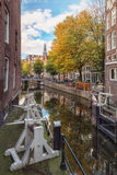 The lock between Сanal Oudezijds Kolk and Oudezijds Voorburgwal. Amsterdam, Netherlands – October 30, 2016: The lock between Сanal Oudezijds Kolk and Royalty Free Stock Photo