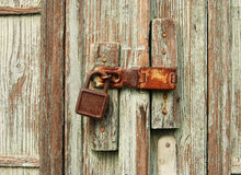 Lock 01. Lock on old wooden door Royalty Free Stock Photos