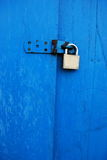 Lock. Metal lock on a blue door Royalty Free Stock Photo