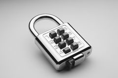 Lock. Combination lock on the plain color background royalty free stock photos