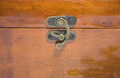 The lock. On a wooden chest with the varnished surface Stock Photography