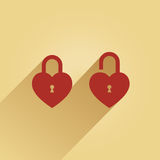 Lock. 2 lock in the shape of a heart one is opened, the other closed Stock Photo