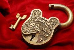 Lock. Antique lock on red background Stock Photos