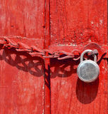 Lock. On red colored door Royalty Free Stock Images