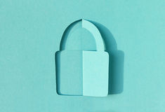 Lock abstract turquoise paper cut symbol Royalty Free Stock Photography