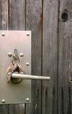 Lock Assembly in the Wooden Door. Metal lock assembly with handle in the wooden door Royalty Free Stock Photos