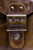 Lock bag. Closed locker on leather texture Royalty Free Stock Photos
