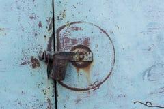 Lock on the blue metal door. stock images