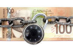 Lock and canadian dollar Royalty Free Stock Image