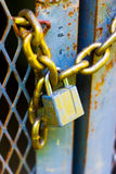 Lock and chain. Macro view of a padlock and chain, keeping a set of doors locked Royalty Free Stock Photography