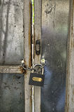 Lock and chain. In a backyard door Royalty Free Stock Photo
