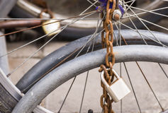 Lock and chain on a bicycle ,Close up view of a large lock Royalty Free Stock Images