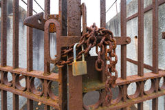 Lock and chain and closed gates royalty free stock photography