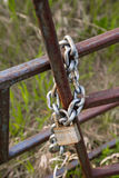 Lock and Chain Keeping Fence Closed Stock Photos