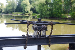 Lock with a chain on the lock screw Stock Image