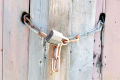 Lock & Chain on Old Wood Texture Background Stock Photos