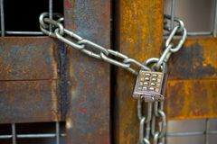 Lock with chain on rusty gate Stock Image