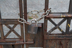 Lock and chain on an rusty gate Stock Image