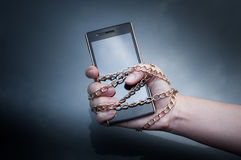 Lock chain smartphone hand woman holding ,Information security. Personal data security and protection concept - metal chain link hand with locked padlock on Stock Photography