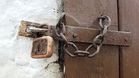 Lock and chain on vintage door Stock Photo