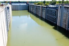 Lock chamber and floodgate at river - part of big dam stock photography
