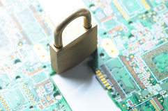 Lock and circuit board Stock Photos