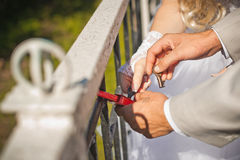 Lock closing on a key. Royalty Free Stock Photo