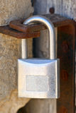 Lock closing an old wooden door Royalty Free Stock Image