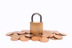 Lock and coins Stock Photography