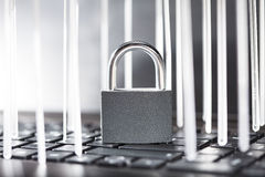 Lock on a computer keyboard. With a luminous vertical bars Stock Photos