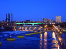Lock and dam and Stone Arch bridge in Minneapolis. Lock and dam and Stone Arch bridge in downtown Minneapolis at dusk Stock Image