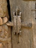 Lock of the door. To a Dogon home with wood carvings, sacred animal figures, idols of the animist religion Stock Images