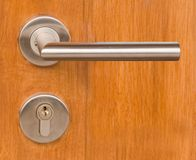 Lock and Door Handle on Wooden Door Stock Photography