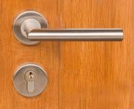 Lock and Door Handle on Wooden Door Stock Photography