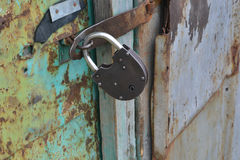 Lock on the door. Iron lock on the door of the secret protection royalty free stock photo