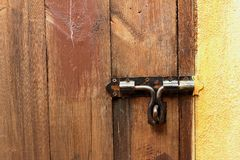 Lock of the door locked with padlock. Stock Image