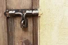 Lock of the door locked with padlock. Royalty Free Stock Photo
